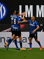 Inter Milan's Alexis Sanchez, right,celebrates with his teammates Roberto Gagliardini, left, and Matias Vecino, after scoring during the Italian Serie A football match between Inter Milan and Sampdoria at Milan's Giuseppe Meazza stadium, May 8, 2021.<br /> UPDATE IMAGES PRESS/Isabella Bonotto