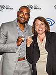 Darren Woodson and Carole Hart swap rings at the Time Warner Media Cabletime Upfront media event held at the Private Social Restaurant  in Dallas, Texas.