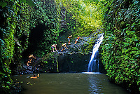 EDITORIAL ONLY. Hikers enjoy a cool dip in the waterfalls and pool at the end of Maunawili Falls Trail