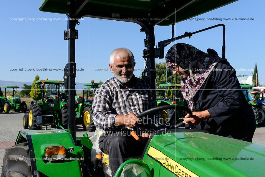 TURKEY Manisa, John Deere Distributor, farmer and his wife buy new tractor / TUERKEI Manisa, John Deere Haendler, Farmer und seine Frau kaufen neuen Traktor