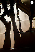 Shadow of woman's foot and furniture on floor (Licence this image exclusively with Getty: http://www.gettyimages.com/detail/sb10066852ah-001 )