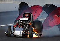 Feb. 15, 2013; Pomona, CA, USA; NHRA funny car driver Tony Pedregon blows the body off his car after an explosion during qualifying for the Winternationals at Auto Club Raceway at Pomona. Pedregon was unhurt in the incident. Mandatory Credit: Mark J. Rebilas-