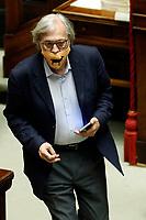 Deputy Vittorio Sgarbi, at the Chamber of Deputies, during the final vote on the Justice Decree, is expelled and brought outside by force by the clerks, after he called the Superior Council of the Judiciary, a Mafia association, and insulted the Vice President of the Chamber and the deputy Giusi Bartolozzi that was talking at the moment. Sgarbi wears a mask with a goat, as he very often insults people with a: You're a Goat!Rome (Italy), June 25th 2020<br /> Vittorio sgarbi viene cacciato dall'Aula della Camera e portato via di forza dai commessi, dopo aver accusato il CSM di essere un'associazione mafiosa e dopo aver insultato le deputata Giusi Bartolozzi e la vice-presidente della Camera Mara Carfagna. Sgarbi indossa una mascherina con una capra, che richiama una delle frasi che dice più' spesso alla gente: sei una capra!<br /> Foto Samantha Zucchi Insidefoto