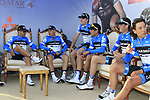 Victorious team Garmin-Cervelo riders wait in the hot seats beside the podium at the end of the 2nd Stage of the 2012 Tour of Qatar an 11.3km team time trial at Lusail Circuit, Doha, Qatar. 6th February 2012.<br /> (Photo Eoin Clarke/Newsfile)