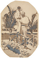 BNPS.co.uk (01202 558833)<br /> Pic: SheldonCarpenter/Witherell'sInc/BNPS<br /> <br /> Pictured: A vintage silver print photograph of Sonny and Al Capone.<br /> <br /> An incredible treasure trove of Al Capone heirlooms have sold at auction for a whopping £2.3m. ($3.1m)<br /> <br /> The star lot was the notorious American gangster's favourite gun - a 1911 Colt semi-automatic pistol, which was expected to fetch £110,000 but sold for an incredible £764,000. ($1.04m)<br /> <br /> The remarkable collection, sold by his granddaughters, included personalised jewellery, photographs and furniture and a letter written to his only child Sonny from Alcatraz Prison, which showed a tender side to the ruthless crime boss.
