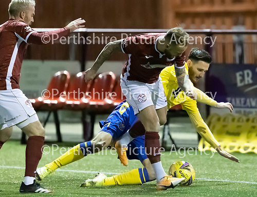 Kelty Hearts v St Johnstone…07.10.20   New Central Park  Betfred Cup<br />Kallum Higginbotham tackles Scott Tanser<br />Picture by Graeme Hart.<br />Copyright Perthshire Picture Agency<br />Tel: 01738 623350  Mobile: 07990 594431