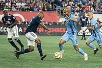 FOXBOROUGH, MA - SEPTEMBER 29: Andrew Farrell #2 of New England Revolution comes in to tackle Heber #9 of New York City FC during a game between New York City FC and New England Revolution at Gillettes Stadium on September 29, 2019 in Foxborough, Massachusetts.