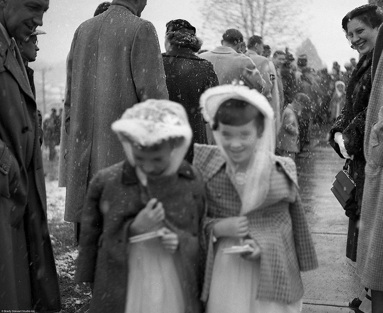 Bethel Park PA:  View of young catholic girls walking out of the church after receiving their first holy communion at Saint Valentine's Church.  Cathy Stewart was part of the class that received their first holy communion in 1954.  St Valentine's school opened in 1953 and is still in operation today.  Brady and Cathy Stewart attended the school from 1st thru 8th grades.  Michael Stewart attended from 1st thru 3rd grades.  He left and went to Hillcrest Elementary school after a disagreement with one of the nuns over a tuna fish sandwich!