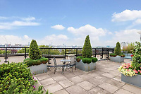 BNPS.co.uk (01202) 558833. <br /> Pic: OrlandoReid/BNPS<br /> <br /> Pictured: Rooftop gaden. <br /> <br /> A flat in a ten-storey Art Deco mansion block that was the fictional home of TV detective Hercule Poirot has gone up for rent for £1,950 a month.<br /> <br /> Grade II listed Florin Court in East London was used for filming the long-running ITV series about Agatha Christie's iconic detective.<br /> <br /> The one-bedroom ground floor flat includes a double bedroom, an open plan reception room and kitchen, and a study or home office and<br /> a marble-tiled family bathroom.<br /> <br /> The exterior of the building has strong Art Deco motifs, many of which were used in the filming of Poirot, for 24 years, from 1989 to 2013.