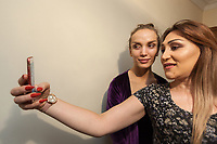 """Armenia. Yerevan. Monica Sarkisyan (L) and her friend Lilit Martirosyan (R) are both transgender women. Selfie session. Lilit Martirosyan is a civil rights activist fighting for the rights of trans people in Armenia. She is the founder and the president of the NGO called """"Right Side"""", founded in 2016 to defend and fight for the rights of the trans community in Armenia. Lilit Martirosyan became on April 5th 2019 the first member of her country's lesbian, gay, bisexual, transgender and intersex (LGBTI) community to deliver a speech on the parliamentary podium, speaking out against discrimination at a session of its committee on human rights. A trans woman (sometimes trans-woman or transwoman) is a woman who was assigned male at birth. Trans women may experience gender dysphoria and may transition; this process commonly includes hormone replacement therapy and sometimes sex reassignment surgery, which can bring immense relief and even resolve gender dysphoria entirely. Yerevan, sometimes spelled Erevan, is the capital and largest city of Armenia. 10.10.2019 © 2019 Didier Ruef"""