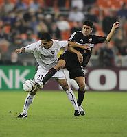 30 October,  2004.   DC United's Alecko Eskandarian (11) collides with Craig Ziadie (21) of the MetroStars during the 2004 MLS playoffs at RFK Stadium in Washington, DC.