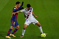 29th December 2020; Camp Nou, Barcelona, Catalonia, Spain; La Liga Football, Barcelona versus Eibar;  Rafa Soares SD EIbar defender holds off Sergino Dest FC Barcelona defender