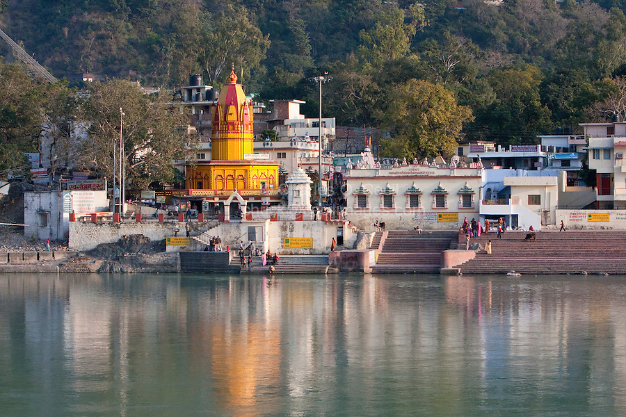 India, Rishikesh.  North Bank of the Ganges (Ganga) and Hindu Temple.