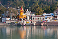 India, Rishikesh.  North Bank of the Ganges (Ganga) and Hindu Temple.