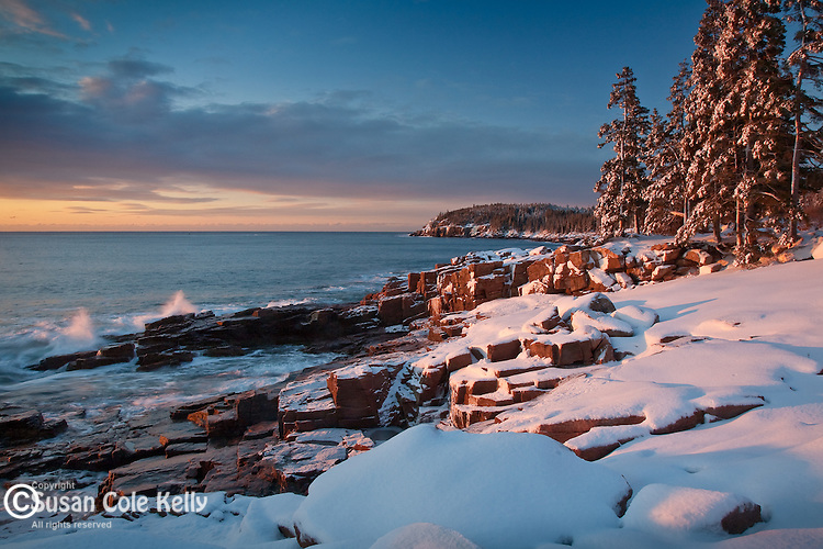 Snow blankets the rocky coast near Otter Cliffs, Acadia National Park, ME, USA