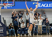 WASHINGTON, DC - JANUARY 29: Jamison Battle #10 of George Washington rejoices at the end of a four overtime GW win during a game between Davidson and George Wshington at Charles E Smith Center on January 29, 2020 in Washington, DC.
