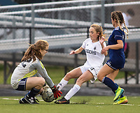 Emma Cornog (42) of Rogers Heritage gets ball as Kayla Hurley (11) of Bentonville attempts to scoore at David Gates Stadium, Rogers, Ark., on Tuesday,, March 30, 2021  / Special to NWA Democrat-Gazette/ David Beach
