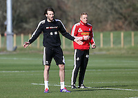 Pictured L-R: Michu and manager Garry Monk. Saturday 08 March 2014<br />