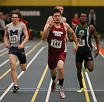 SPEARFISH, S.D. -- FEBRUARY 23, 2013 -- Phil Rivera of Chadron State crosses the finish line first in the men's 400m event Saturday during the 2013 RMAC Men's and Women's Track and Field Championships at the Donald Young Center on the campus of Black Hills State University.   Also pictured are Peter Jenkins #223 of Colorado Mines and Derek Brown #26 of Adams State.  (Photo by Richard Carlson/dakotapress.org)