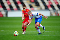 Angharad James of Wales Women's vies for possession with Heidi Sevdal of Faroe Islands Women's during the UEFA Women's EURO 2022 Qualifier match between Wales Women and Faroe Islands Women at Rodney Parade in Newport, Wales, UK. Thursday 22 October 2020