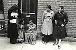 """Grunwick Strike North London UK. 1977. Women on left is holding a """"Grunwick Strike Committee APEX"""" leaflet.<br /> <br /> Nirmal Ram sits on the doorstep (left) if you know the names of the other people please get in touch.<br /> <br /> Name thanks to Graham Taylor."""