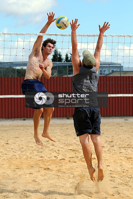 Andy Laing spikes the ball during the Brightwater Grand Slam beach volleyball tournament. Brightwater, Nelson, New Zealand. Saturday 22 December 2012. Credit Chris Symes/www.shuttersport.co.nz