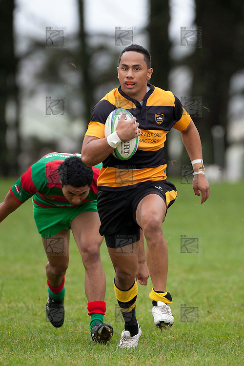 Ray Laulala fails to catch up with the hard running Sione Olive as he counter attacks through the midfield.  Counties Manukau Premier Club Rugby game between Bombay and Waiuku played up on the hill at Bombay on March 26th 2011. Waiuku won 57 - 10 after leading 24 - 3 at halftime.