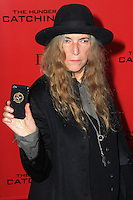 """NEW YORK, NY - NOVEMBER 20: Patti Smith at the New York Premiere Of Lionsgate's """"The Hunger Games: Catching Fire"""" held at AMC Lincoln Square Theater on November 20, 2013 in New York City. (Photo by Jeffery Duran/Celebrity Monitor)"""