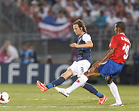 USMNT midfielder Mix Diskerud (8) clears the ball. In CONCACAF Gold Cup Group Stage, the U.S. Men's National Team (USMNT) (blue/white) defeated Costa Rica (red/blue), 1-0, at Rentschler Field, East Hartford, CT on July 16, 2013.