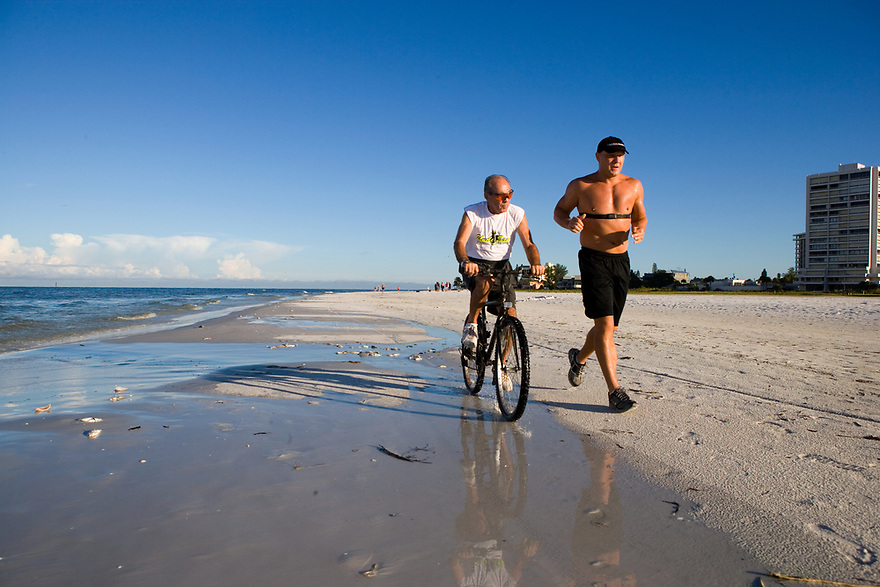 German Heavyweight Boxer Axel Schultz trains on Siesta Key near Sarasota, Florida for his comeback fight in Germany in November. Photographed September 5, 2006 for Der Spiegel magazine. His manger is Wolfram Koehler (in blue) and his Coach is Rick Conte (white T-shirt)