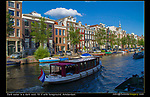 Netherlands, Amsterdam.  Without this boat passing through, this canal and water would be a dark void, so fill it with something interesting. Amsterdam, Netherlands.