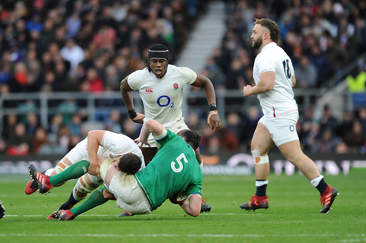 James Ryan of Ireland is tackled by Charlie Ewels as Maro Itoje of England looks on during the Guinness Six Nations match between England and Ireland at Twickenham Stadium on Sunday 23rd February 2020 (Photo by Rob Munro/Stewart Communications)