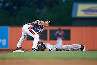Aberdeen Ironbirds second baseman Drew Turbin (32) puts the tag on Aaron Mizell (8) sliding into second during a game against the Tri-City ValleyCats on August 6, 2015 at Ripken Stadium in Aberdeen, Maryland.  Tri-City defeated Aberdeen 5-0 in a combined no-hitter.  (Mike Janes/Four Seam Images)