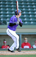 Left fielder Jake Jones (6) of the Furman Paladins hits in a game against the Miami (Ohio) Redhawks on Sunday, February 17, 2013, at Fluor Field at the West End in Greenville, South Carolina. Furman won, 6-5. (Tom Priddy/Four Seam Images)