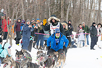 Nicolas Petit and team run past spectators on the bike/ski trail near University Lake with an Iditarider in the basket and a handler during the Anchorage, Alaska ceremonial start on Saturday, March 7 during the 2020 Iditarod race. Photo © 2020 by Ed Bennett/Bennett Images LLC