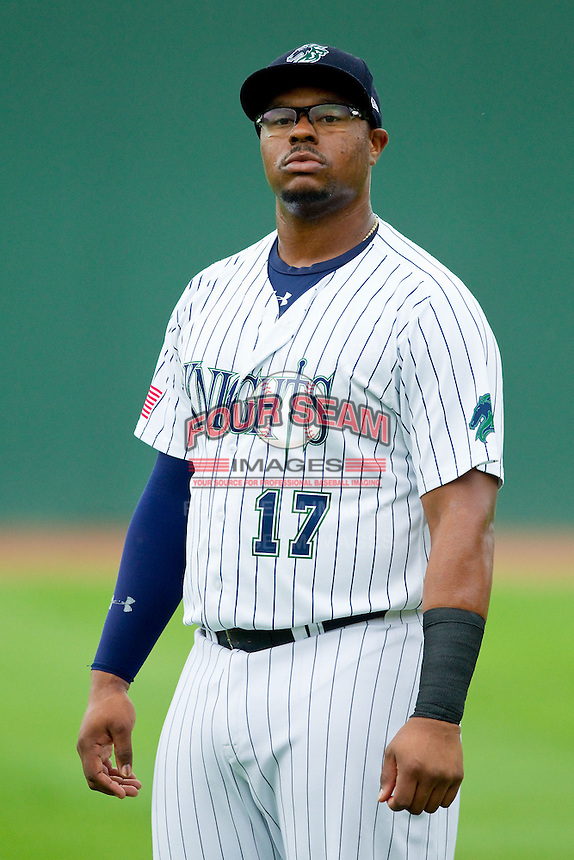 Charlotte Knights first baseman Mike McDade (17) warms up in the outfield prior to the game against the Lehigh Valley IronPigs at Knights Stadium on August 6, 2013 in Fort Mill, South Carolina.  The IronPigs defeated the Knights 4-1.  (Brian Westerholt/Four Seam Images)