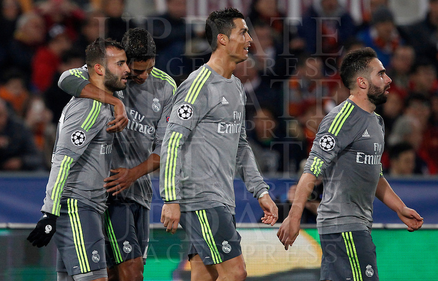 Calcio, andata degli ottavi di finale di Champions League: Roma vs Real Madrid. Roma, stadio Olimpico, 17 febbraio 2016.<br /> Real Madrid's Jese', left, celebrates with teammates, from second left, Raphael Varane, Cristiano Ronaldo and Dani Carvajal, after scoring during the first leg round of 16 Champions League football match between Roma and Real Madrid, at Rome's Olympic stadium, 17 February 2016.<br /> UPDATE IMAGES PRESS/Riccardo De Luca