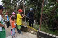 COCORNA - COLOMBIA, 15-04-2015. Niños juegan al lado de una campo minado en el municipio de Cocorná, Antioquia, Colombia en donde miembros del ejercito de Colombia realizan un entrenamiento  de desminado en el sector Campo Alegre 16 abril de 2015./ Boys play soccer next to the minefield in Cocorna municipality, Antioquia department, Colombia where Colombian Army soldiers take a demining training in Campo Alegre region, on April 16, 2015.  Photo: VizzorImage/ León Monsalve /STR