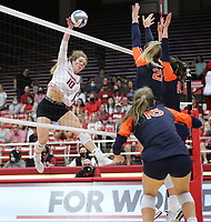 Arkansas Junior Jillian Gillen (10) spikes ball against Tatum Shipes (21) and Jackie Barrett (10) of Auburn on Sunday, Oct. 10, 2021, during play at Barnhill Arena, Fayetteville. Visit nwaonline.com/211011Daily/ for today's photo gallery.<br /> (Special to the NWA Democrat-Gazette/David Beach)