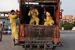 10/10/2014 -- Kirkuk, Iraq -- Bangladeshi workers in the trash car set out to clean the streets of Kirkuk.