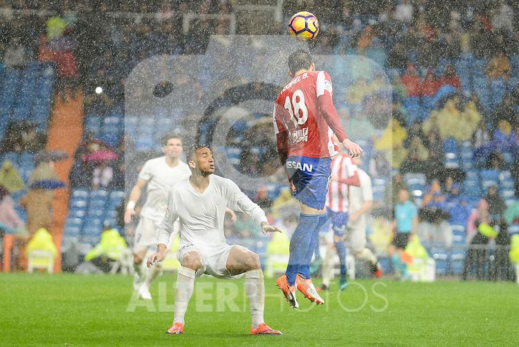 Real Madrid's player Danilo Luiz Da Silva and Sporting de Gijon's player Ismael López during match of La Liga between Real Madrid and Sporting de Gijon at Santiago Bernabeu Stadium in Madrid, Spain. November 26, 2016. (ALTERPHOTOS/BorjaB.Hojas)