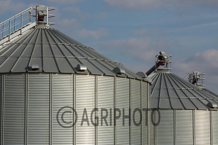 Oilseed rape in flower in front of grain storage bins<br /> Picture Tim Scrivener 07850 303986