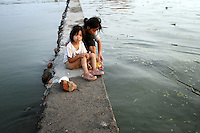 A homeless woman and her child on the shores of Dongting Lake, Hunan Province. Dongting Lake has decreased in size in recent decades as a result of land reclamation and damming of the Yangtze. China. 2010
