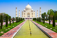 Iconic Taj Mahal ivory-white marble mausoleum over the great entrance gate, on the bank of the Yamuna river in Agra, Uttar Pradesh, India