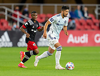 WASHINGTON, DC - MAY 13: Wyatt Omsberg #20 of Chicago Fire FC dribbles the ball during a game between Chicago Fire FC and D.C. United at Audi FIeld on May 13, 2021 in Washington, DC.