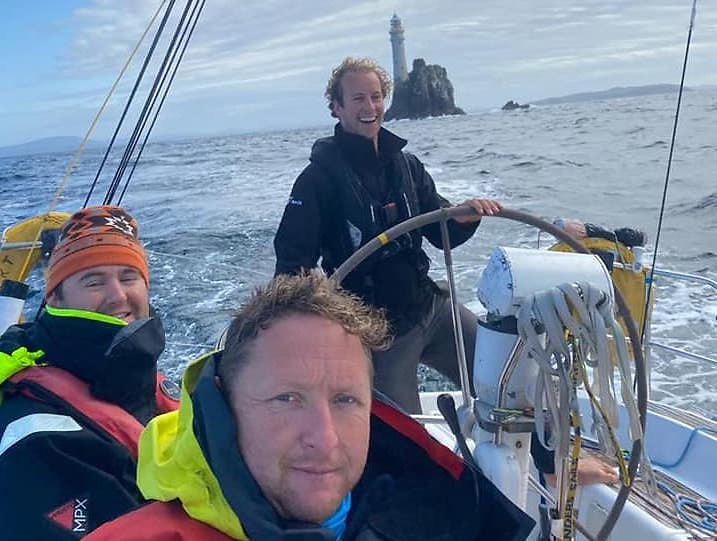 Conor Totterdell (NYC) on the helm of Irish Offshore Sailing's Desert Star at the Fastnet Rock