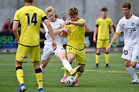 Thomas Raimbault of the Wellington Phoenix competes for the ball with Daniel Edwards of Eastern Suburbs during the ISPS Handa Men's Premiership - Wellington Phoenix v Eastern Suburbs at Fraser Park, Wellington on Saturday 28 November 2020.<br /> Copyright photo: Masanori Udagawa /  www.photosport.nz