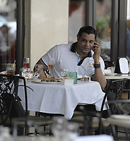 """BAL HARBOUR, FL - AUGUST 14: (EXCLUSIVE COVERAGE) Samuel Peralta """"Sammy"""" Sosa (born November 12, 1968) is a former Major League Baseball right fielder. Sammy is seen here eating at Carpaccio restaurant in Bal Haubour shops.  <br /> <br /> Sosa's Major League career began with the Texas Rangers in 1989. After a stint with the Chicago White Sox, Sosa became a member of the Chicago Cubs in 1992 and subsequently became one of the league's best hitters. In 1998, Sosa and Mark McGwire achieved national fame for their home run-hitting prowess in pursuit of Roger Maris' home run record. Although a fan favorite, Sosa fell out of favor in Chicago after he was caught using a corked bat in a 2003 game and later left the team during the final game of the 2004 season. Sosa finished his career with brief stints with the Baltimore Orioles and the Texas Rangers.[1] With the Rangers, Sosa hit his 600th career home run to become the fifth player in MLB history to reach the milestone. He is also the all-time home run leader among foreign-born MLB players. Furthermore, Sosa is one of only two National League Players to ever reach 160 RBI, a milestone he reached in 2001. The other was Cubs player and RBI Champion Hack Wilson during his record setting 1930 season in which he hit 191 RBI. Sosa is the only player to have hit 60 or more home runs three times.<br /> <br /> Sosa has long been the subject of speculation about suspected anabolic steroid use during his playing career. On June 16, 2009, The New York Times reported that Sammy failed a test for performance enhancing drugs in 2003.   on August 14, 2010 in Miami Beach Florida.<br /> <br /> <br /> People:  Sammy Sosa"""
