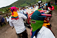 """A man dancer, wearing a colorful masque of Aya Uma - the creature from the Indian myths, leads the procession during the Inti Raymi fiesta in Pichincha province, Ecuador, 26 June 2010. Inti Raymi, """"Festival of the Sun"""" in Quechua language, is an ancient spiritual ceremony held in the Indian regions of the Andes, mainly in Ecuador and Peru. The lively celebration, set by the winter solstice, goes on for various days. The highland Indians, wearing beautiful costumes, dance, drink and sing with no rest. Colorful processions in honor of the God Inti (Sun) pass through the mountain villages giving thanks for the harvest and expressing their deep relation to the Mother Earth (Pachamama)."""