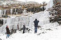 WEATHER PICTURE WALES<br /> Pictured: People have been visiting a frozen waterfall at Storey Arms in the Brecon Beacons, Wales, UK. Saturday 03 March 2018<br /> Re: Storm Emma and Beast from the East has been affecting most parts of the UK.